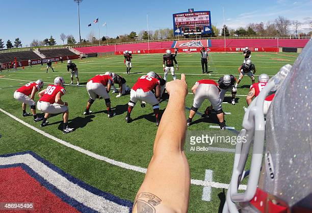 Quarterback Conor Bednarski of the Stony Brook Offense shouts instructions before the snap during their Spring Football Game at Kenneth P LaValle...
