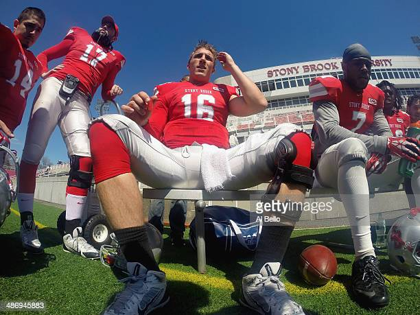 Quarterback Conor Bednarski of the Stony Brook Offense sits on the bench during their Spring Football Game at Kenneth P LaValle Stadium on April 26...