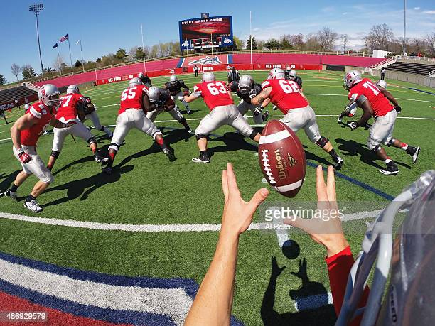 Quarterback Conor Bednarski of the Stony Brook Offense takes the snap from Center Mike White during their Spring Football Game at Kenneth P LaValle...