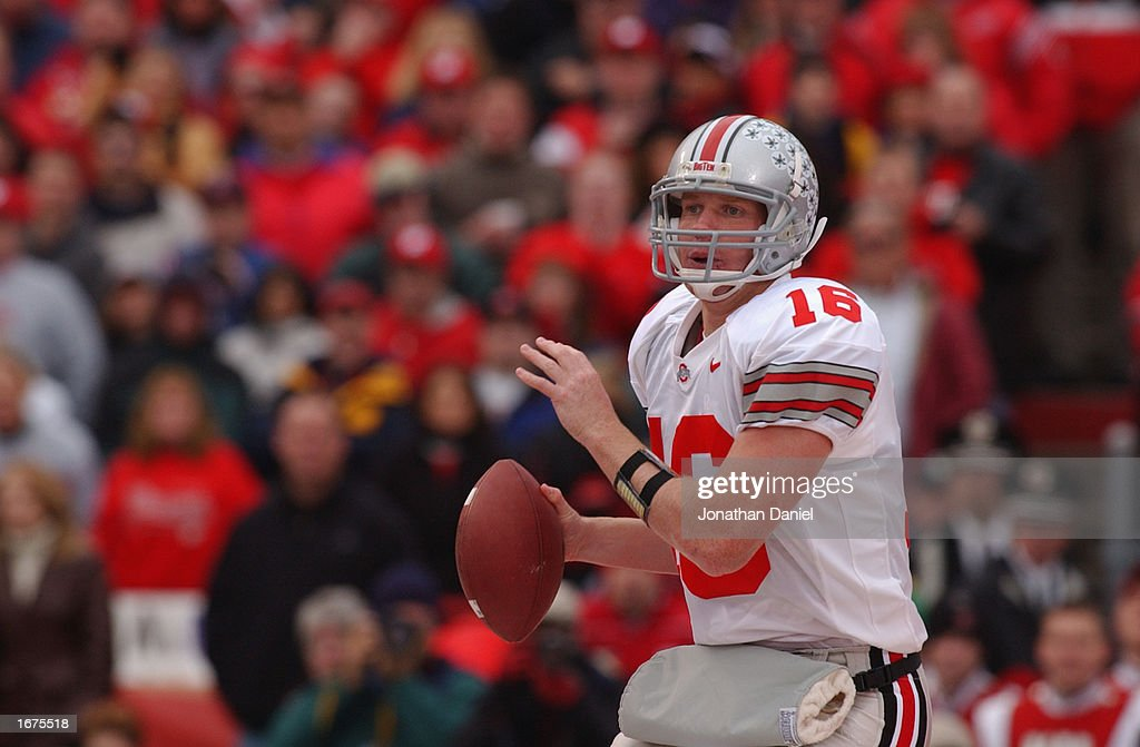 Quarterback Craig Krenzel #16 of the Ohio State Buckeyes looks to pass during the Big Ten Conference football game against the Wisconsin Badgers at Camp Randall Stadium on October 19, 2002 in Madison, Wisconsin. The Buckeyes won 19-14.