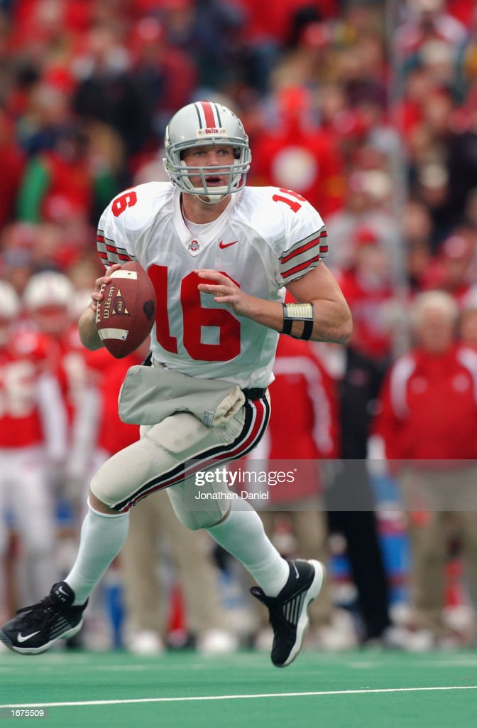 Quarterback Craig Krenzel #16 of the Ohio State Buckeyes rolls to his right during the Big Ten Conference football game against the Wisconsin Badgers at Camp Randall Stadium on October 19, 2002 in Madison, Wisconsin. The Buckeyes won 19-14.