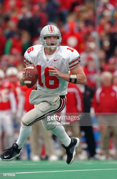Quarterback Craig Krenzel of the Ohio State Buckeyes rolls to his right during the Big Ten Conference football game against the Wisconsin Badgers at...