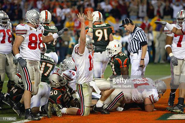 Quarterback Craig Krenzel of the Ohio State Buckeyes scores the team's first touchdown in overtime against the University of Miami Hurricanes during...