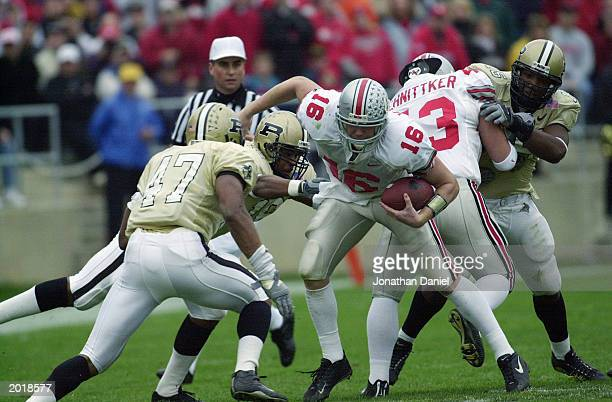 Quarterback Craig Krenzel of the Ohio State University Buckeyes is tackled by the Purdue University Boilermakers during the game at Ross-Ade Stadium...