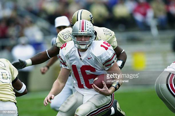 Quarterback Craig Krenzel of the Ohio State University Buckeyes scrambles with the ball against the Purdue University Boilermakers during the game at...