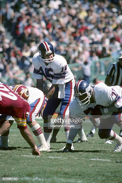 Quarterback Craig Morton#15 of the New York Giants calls out the signals during a game on September 12 1976 against the Washington Redskins at RFK...