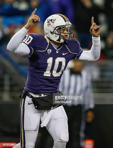Quarterback Cyler Miles of the Washington Huskies celebrates a touchdown scored by Dwayne Washington against the Colorado Buffaloes on November 9,...
