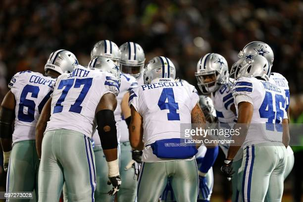 Quarterback Dak Prescott of the Dallas Cowboys calls a play in the huddle during the game against the Oakland Raiders at OaklandAlameda County...