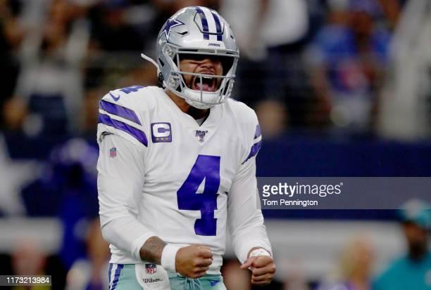 Quarterback Dak Prescott of the Dallas Cowboys celebrates after connecting with Ezekiel Elliott of the Dallas Cowboys to score a touchdown in the...