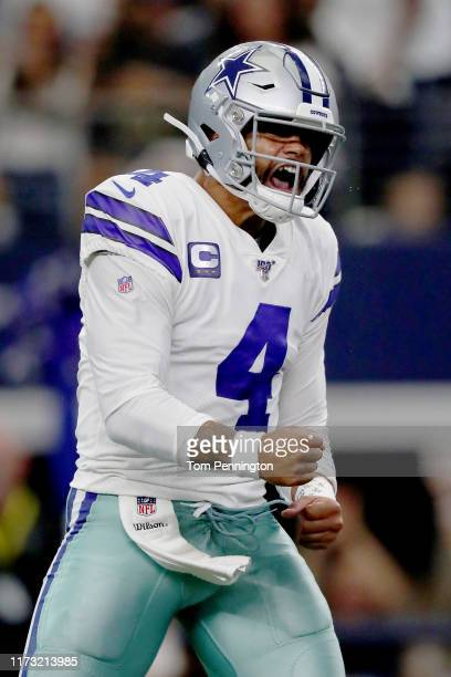 Quarterback Dak Prescott of the Dallas Cowboys celebrates after connecting with Ezekiel Elliott of the Dallas Cowboys to score a touchdown in the...