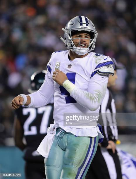 Quarterback Dak Prescott of the Dallas Cowboys celebrates rushing 1 yard for a touchdown against the Philadelphia Eagles in the second quarter during...