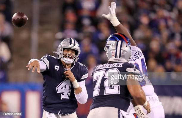 Quarterback Dak Prescott of the Dallas Cowboys delivers a pass over the defense of the New York Giants during the game at MetLife Stadium on November...