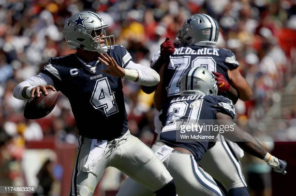 Quarterback Dak Prescott of the Dallas Cowboys drops back to pass in first half action against the Washington Redskins at FedExField on September 15...