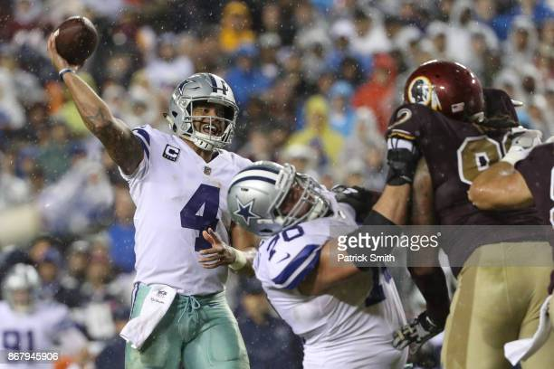 Quarterback Dak Prescott of the Dallas Cowboys drops back to pass against the Washington Redskins during the fourth quarter at FedEx Field on October...