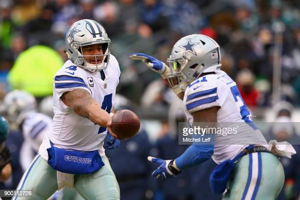 Quarterback Dak Prescott of the Dallas Cowboys hands off the ball to running back Ezekiel Elliott against the Philadelphia Eagles during the second...