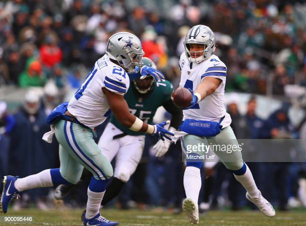 Quarterback Dak Prescott of the Dallas Cowboys handsoff the ball to running back Ezekiel Elliott against the Philadelphia Eagles during the first...
