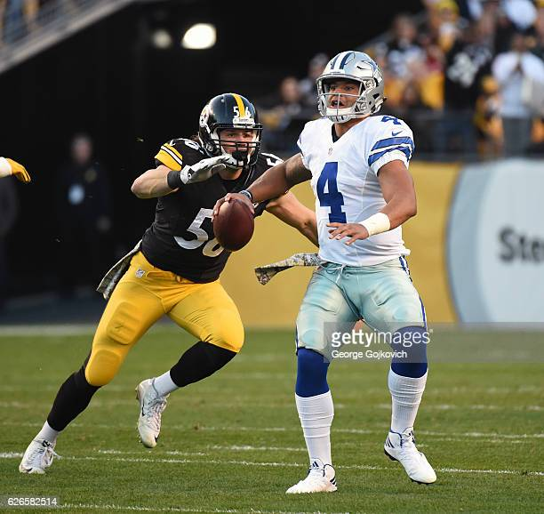 Quarterback Dak Prescott of the Dallas Cowboys looks to pass as he is pressured by linebacker Anthony Chickillo of the Pittsburgh Steelers during a...