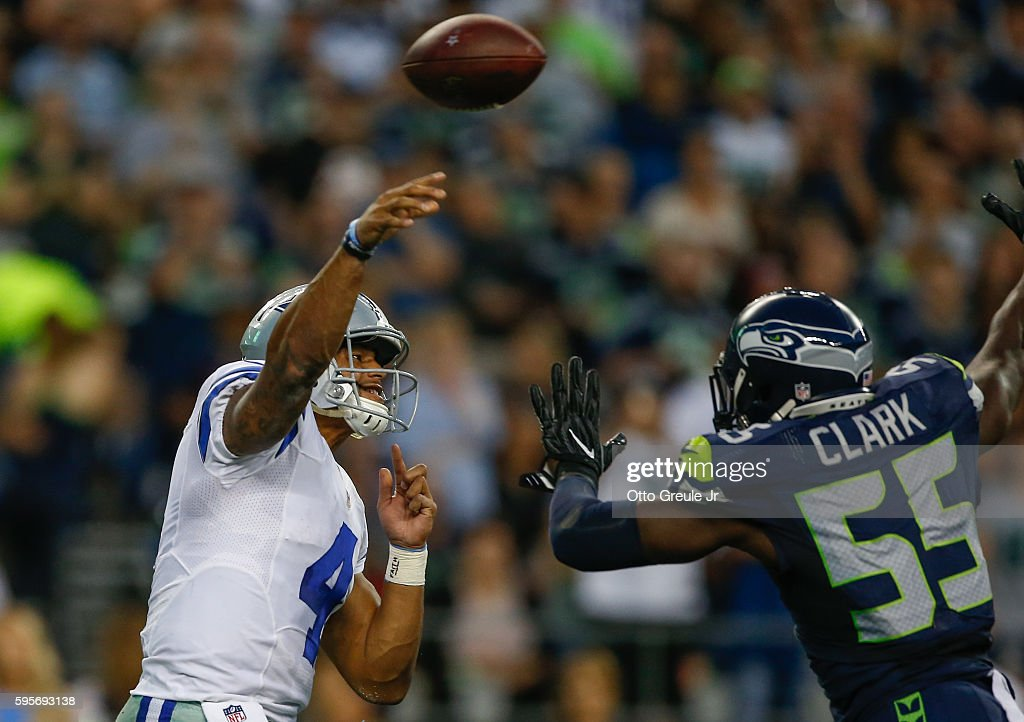 Quarterback Dak Prescott #4 of the Dallas Cowboys passes against defensive end Frank Clark #55 of the Seattle Seahawks at CenturyLink Field on August 25, 2016 in Seattle, Washington. The Seahawks defeated the Cowboys 27-17.