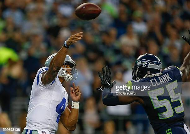 Quarterback Dak Prescott of the Dallas Cowboys passes against defensive end Frank Clark of the Seattle Seahawks at CenturyLink Field on August 25...