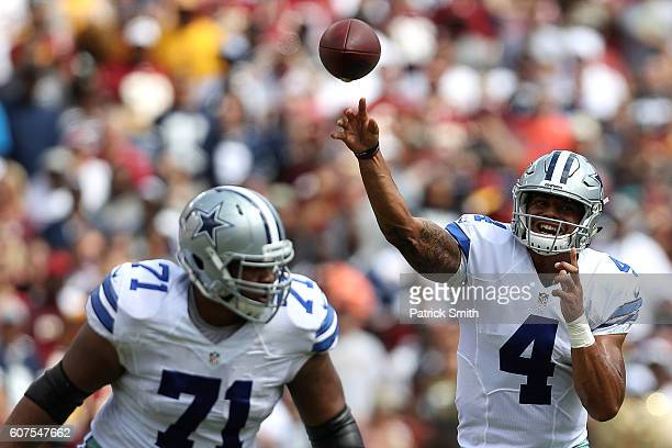 Quarterback Dak Prescott of the Dallas Cowboys passes while teammate offensive guard La'el Collins blocks against the Washington Redskins in the...