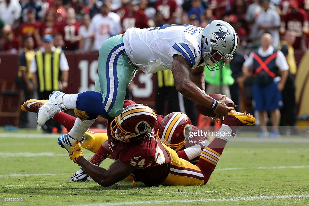 Quarterback Dak Prescott #4 of the Dallas Cowboys scores a third quarter touchdown past inside linebacker Mason Foster #54 of the Washington Redskins at FedExField on September 18, 2016 in Landover, Maryland.