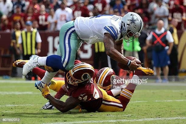 Quarterback Dak Prescott of the Dallas Cowboys scores a third quarter touchdown past inside linebacker Mason Foster of the Washington Redskins at...