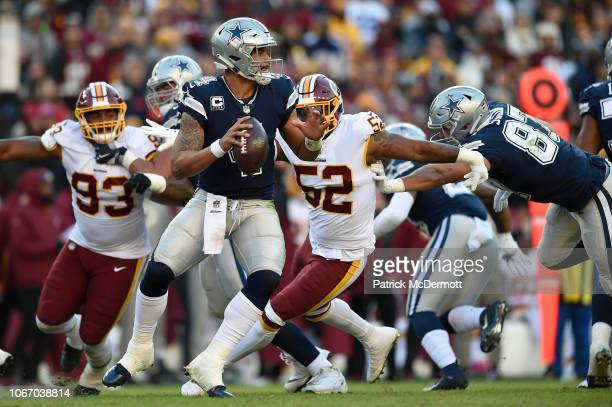 Quarterback Dak Prescott of the Dallas Cowboys throws a pass in the second quarter against the Washington Redskins at FedExField on October 21 2018...