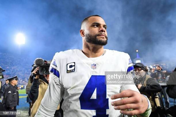 Quarterback Dak Prescott of the Dallas Cowboys walks off the field after losing the NFC Divisional Round playoff game to the Los Angeles Rams at Los...