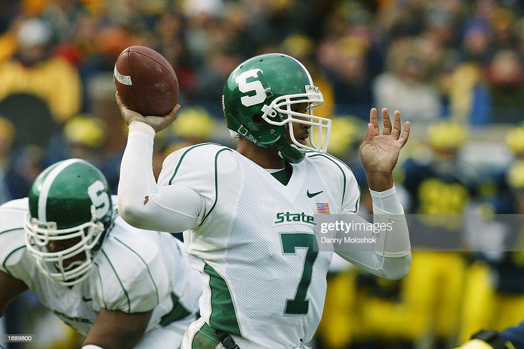 Quarterback Damon Dowdell #7 of the Michigan State Spartans throws a pass against the Michigan Wolverines during the game on November 2, 2002 at Michigan Stadium in Ann Arbor, Michigan. Michigan won 49-3.