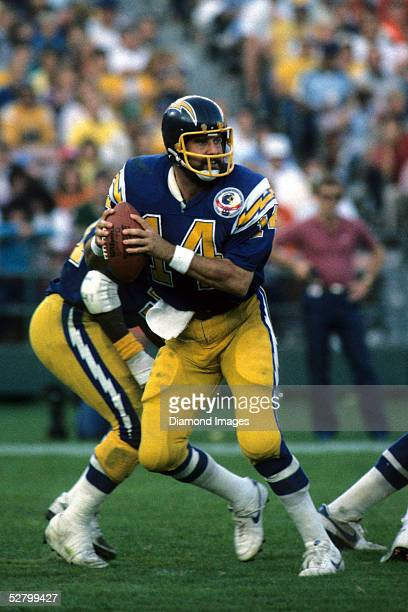 Quarterback Dan Fouts of the San Diego Chargers drops back to pass during a game on September 22 1985 against the Cincinnati Bengals at Riverfront...