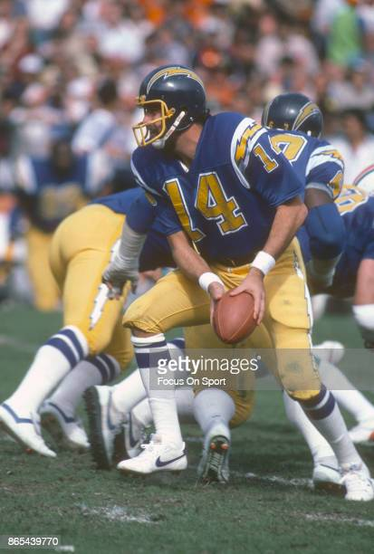 Quarterback Dan Fouts of the San Diego Chargers in action against the Miami Dolphins during an NFL football game circa 1983 at the Orange Bowl in...