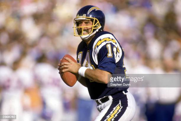 Quarterback Dan Fouts of the San Diego Chargers looks to pass during a 1987 NFL game