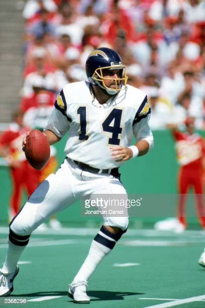 Quarterback Dan Fouts of the San Diego Chargers looks to pass during a game against the Kansas City Chiefs at the Arrowhead Stadium during the 1987...