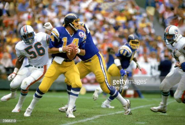 Quarterback Dan Fouts of the San Diego Chargers looks to pass during a game against the Miami Dolphins at Jack Murphy Stadium during the 1983 NFL...