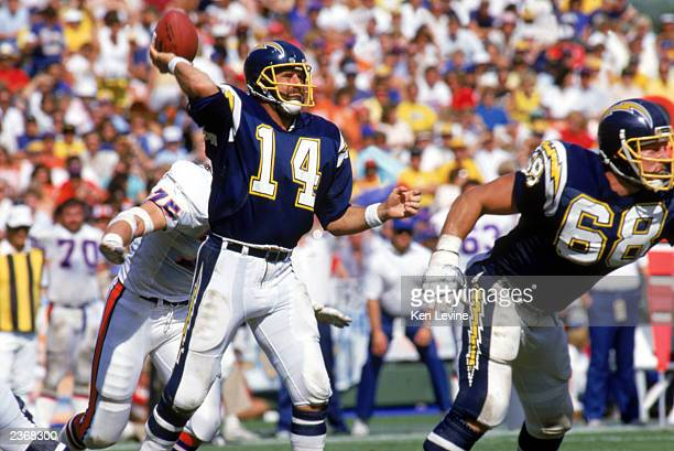 Quarterback Dan Fouts of the San Diego Chargers passes the ball during a game against the Denver Broncos at Jack Murphy Stadium during the 1987 NFL...