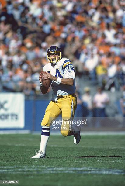 Quarterback Dan Fouts of the San Diego Chargers rolls out during the game against the Denver Broncos at Mile High Stadium on September 27 1981 in...