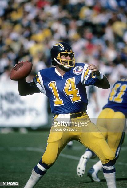 Quarterback Dan Fouts of the San Diego Chargers sets up to throw a pass against the Los Angeles Raiders during an NFL football game October 21 1984...
