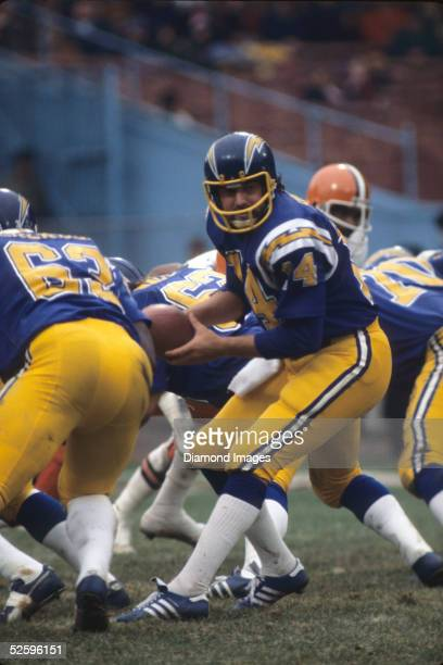 Quarterback Dan Fouts of the San Diego Chargers turns to hand the ball off during a game on October 28 1973 against the Cleveland Browns at Municipal...