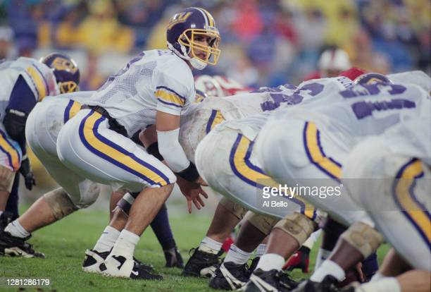 Quarterback Dan Gonzalez of the University of East Carolina Pirates prepares to take the snap during a NCAA Atlantic Coast Conference college...