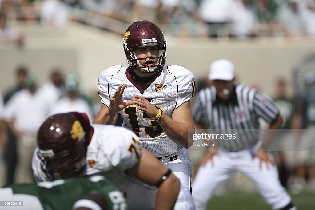 Quarterback Dan LeFevour #13 of the Central Michigan Chippewas looks over the defense in the first quarter against the Michigan State Spartans at Spartan Stadium on September 12, 2009 in East Lansing, Michigan. Central Michigan won the game 29-27. Photo by Leon Halip/Getty Images)