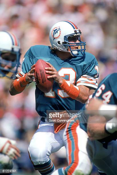 Quarterback Dan Marino of the Miami Dolphins drops back to pass during a game against the Washington Redskins at RFK Memorial Stadium on September 2...