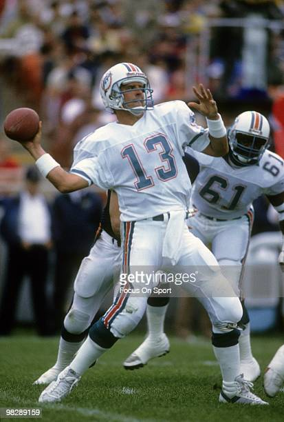 Quarterback Dan Marino of the Miami Dolphins drops back to pass against the Chicago Bears December 2 1985 during an NFL football game at Joe Robbie...