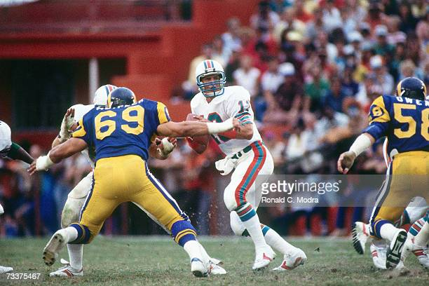 Quarterback Dan Marino of the Miami Dolphins goes back to pass against the Los Angeles Rams on October 30, 1983 in Miami, Florida.