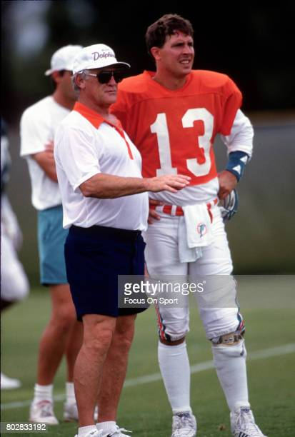 Quarterback Dan Marino of the Miami Dolphins looks on with head coach Don Shula during a practice circa 1991 in Miami Florida Marino played for the...