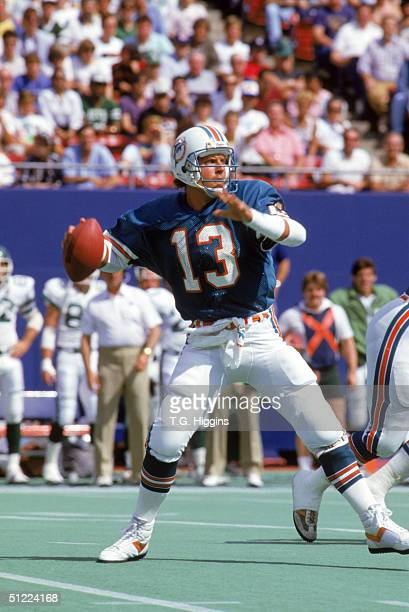 Quarterback Dan Marino of the Miami Dolphins looks to pass during a game against the New York Jets at Giants Stadium on September 21 1986 in East...