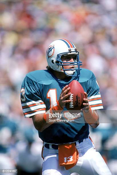 Quarterback Dan Marino of the Miami Dolphins looks to pass during a game against the Washington Redskins at RFK Memorial Stadium on September 2 1984...