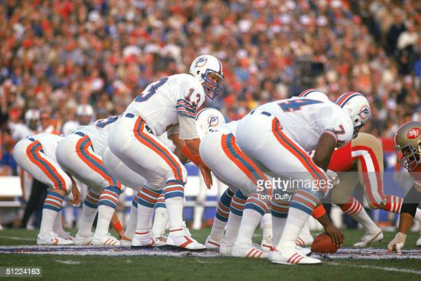 Quarterback Dan Marino of the Miami Dolphins prepares to snap the ball against the San Francisco 49ers in Super Bowl XIX at Stanford Stadium on...