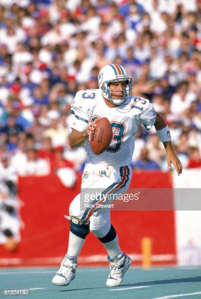 Quarterback Dan Marino of the Miami Dolphins runs with the ball during a game against the Buffalo Bills at Ralph Wilson Stadium on October 29 1989 in...