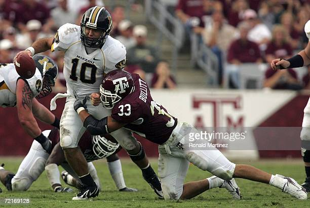 Quarterback Daniel Chase of the Missouri Tigers is sacked by Melvin Bullitt of the Texas AM Aggies at Kyle Field on October 14 2006 in College...