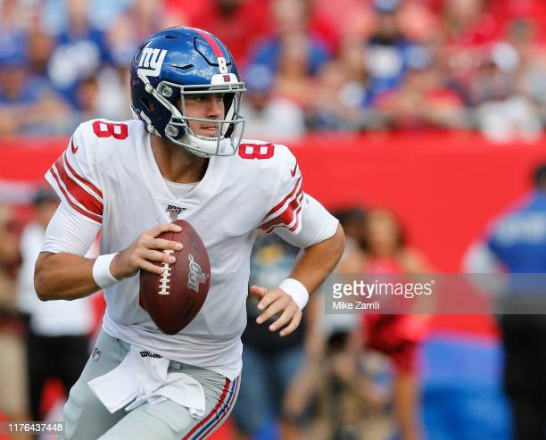 Quarterback Daniel Jones of the New York Giants rolls out during the game against the Tampa Bay Buccaneers at Raymond James Stadium on September 22,...